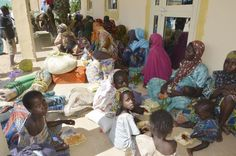 Women and children rest in Maiduguri, Nigeria, after being rescued from Boko Haram extremists by soldiers on Thursday.