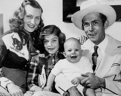 Hank Williams poses with his family Audrey Williams, Lycretia Williams, and Hank Jr. in 1949.