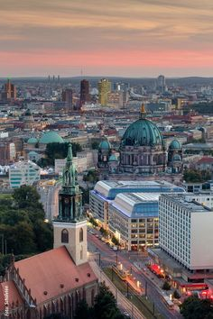 Berlin at dusk - looking towards Potsdamer Platz (high-rise buildings centered in the distance), the Berlin Cathedral (in the middle, slightly to the right), St. Mary's Church (lower left)