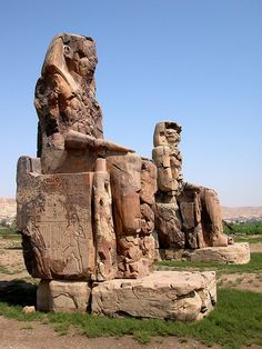 Colossi of Memnon by Dennis Jarvis on Flickr.  Amenhotep III (18th Dynasty) built a mortuary temple in Thebes that was guarded by two gigantic statues on the outer gates. All that remains now are the 23 meter (75 ft) high, one thousand ton statues of Amenhotep III.  There is more info on the history of these statues on the site.