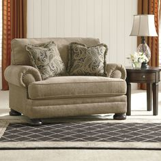 Features:  -Reversible seat cushion.  -2 accent pillows.  -Scotch guard: No.  Chair Design: -Chair and a half.  Frame Finish: -Brown.  Upholstered: -Yes.  Frame Material: -Manufactured wood.  Country