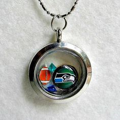 NFL Seattle Seahawks Living Locket Necklace by Sports Jewelry Studio.  $23.50.  5-star customer rating.  www.etsy.com/shop/sportsjewelrystudio