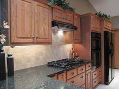 Hmm... I like how close in color those cabinets are to our own, this might work!