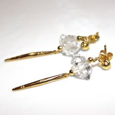 These earrings are modern and fabulous. Gem quality Herkimer diamond faceted nuggets are highlighted by gold needle spikes. These earrings are on a