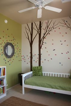There's something about an enchanted forest that imparts a world of possibility. Whether your child is bewitched by fairies, enamored by fables, or simply loves the great outdoors, a room with towering trees and butterfly wall art makes for a magical space. Opt for grassy green bedding for a look your kid won't soon outgrow. See more at Such the Spot »