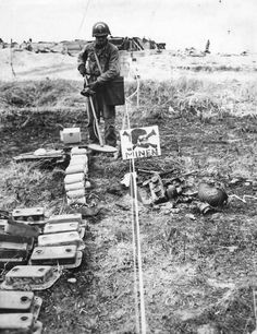 US Army Soldier in German Mine Field in Normandy 1944.