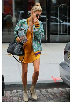 STYLECASTER   Hailey Baldwin Best Street Style Guide   printed aqua bomber and yellow slip dress