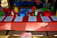 one of the tables, goodie bags, my homemade crayons, lego color pages, bubbles, chalk