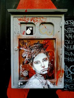Paris Street Art - I'm not surprised this is in Paris. When I was at the Louvre I saw a guy painting a tiny little masterpiece in a tiny sketchbook. He had a tiny brush and paints in a thing about the size of an Altoids box, and was making his own version of something.