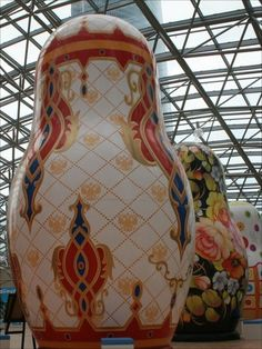 Giant nesting dolls.  Each is decorated in a different style of traditional Russian folk art.
