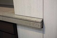 interfacing detail of marble countertop and adjacent timber cabinet