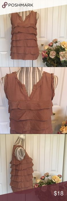ANN TAYLOR LOFT Blush Brown Silk Blend Ruffle Too This Ann Taylor Loft sleeveless warm blush brown ruffle top is a cotton/silk blend with pretty pleating around the neck and ruffles around the torso.  Size S, measures approximately 18 inches pit to pit and 24.5 inches shoulder to hem. No stretch.  Versatile top can be worn for work or out with friends!  No holes, stains, snags, tears.  Price firm unless bundled 😊 LOFT Tops Blouses