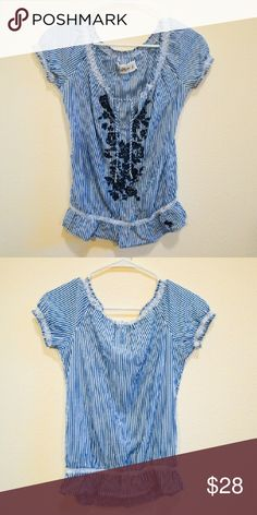 BABYDOLL Abercrombie & Fitch Blouse Abercrombie & Fitch Babyboll Blouse Blouse/ Lightweight/ Decorative Navy Floral Embroidery/ Blue & White/ Great fit/ In Perfect Condition  100% Viscose. Machine wash cold, tumble dry low, warm iron.  Feel free to ask questions, make reasonable offers, share and find a friend and teammate in me. Thanks for the love too! :)) Abercrombie & Fitch Tops Blouses