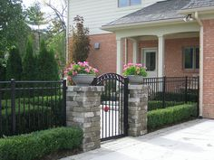 Side of house fence and gate.....Earth Environments has been recognized for numerous landscape design awards. View the awards and award winning designs here.