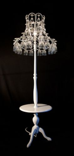 Upcycled wine glasses and standard lamp. Finished in gloss white paint.