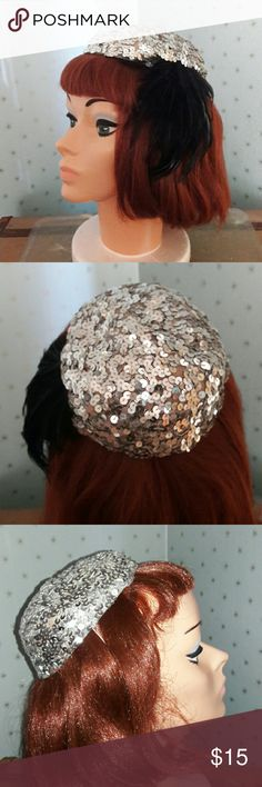 True Vintage! Sequin hat with black feathers!! Fun and fabulous vintage silver sequin hat with black feathers. There is an elastic band that holds it in place. Sparkly and fun! Accessories Hats