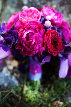 elegant malibu wedding with bold wedding flowers purple pink bouquet | OneWed.com