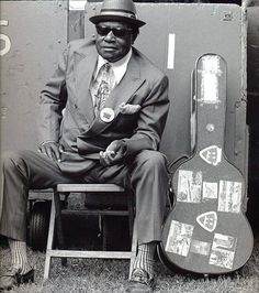 Delta blues legend BUKKA WHITE may just be the coolest cat in town. Herb Wise took this iconic photo of him in 1974.