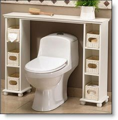 Over the toilet space-saver: 2 CD towers and a shelf, wooden balls for feet and baskets for the shelves...I LOVE this and it would work no matter how much space you have between toilet and tub...if you don't have enough room for 2 towers, use 1 tower and the wall...or if walls are your problem just measure between and cut board to size and hang just the shelf.