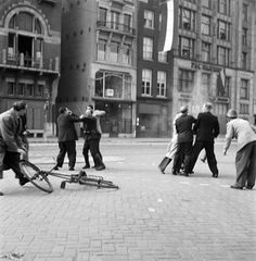 A German soldier is attacked by a group of Dutch civilians and members of the Dutch Resistance on the Rokin in Amsterdam during the liberation of the city from the German garrison as the Canadian Army rolled into the city.