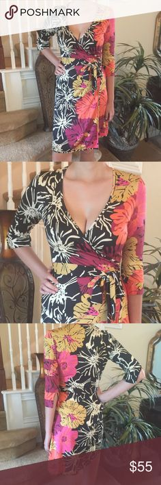 Julie Brown Floral Wrap dress This Julie Brown is stunning! It features a wrap style in a fabulous floral print with a pop of color on one side and 3/4 sleeve. Purchased at Saks and in perfect condition Julie Brown Dresses