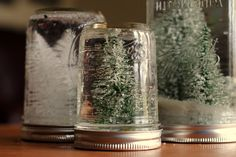 Check out the homemade mason jar snow globes!  Totally doable with the kids, and totally cute enough that even my mother would put them out!