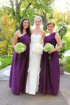 One of our beautiful brides with a couple of her bridesmaids in Alfred Sung, Majestic Peau de Soie dresses!