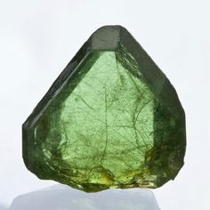 Peridot also known as gem Olivine and Chrysolite Protects against nervousness; helps alleviate spiritual fear; aids in healing hurt feelings & bruised egos; incurs strength & physical vitality; aligns subtle bodies; amplifies other vibrational energies & positive emotional outlook; helps liver & adrenal function.  Helps one to find happiness within one's self, overcoming anger and jealousy.