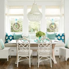 Give a breakfast area a holiday finish with shell wreaths hung with pale blue ribbon.