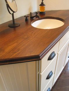 Custom solid wood face grain Walnut counter top with Dark Walnut stain and under mount sink.