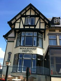 """See 15 photos and 7 tips from 107 visitors to Boulevard Hotel Scheveningen. """"Pretty nice place with cozy rooms, perfect staff and tasty breakfast. Cozy Room, Four Square, Holland, The Good Place, Multi Story Building, Mansions, House Styles, Places, Home Decor"""