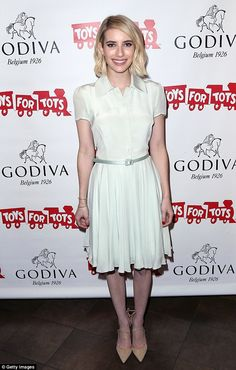 What a sweetheart: Emma Roberts did her bit in a clean white dress at Godiva's Hot Cocoa F...