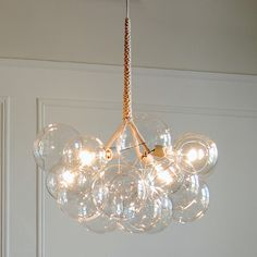 Jean Pelle DIY bubble chandelier project with step-by-step instructions and a detailed parts list. Enjoy the warmth and beauty of a DIY bubble chandelier in Chandelier Bulle, Chandelier Design, Bubble Chandelier, Glass Chandelier, Chandeliers, Chandelier Lighting, Apparatus Lighting, Modern Chandelier, Home Lighting
