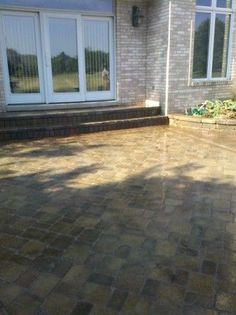 Unilock brick paver patio after being sealed with wet look sealer by Paver Protector Inc.  | www.paverprotector.com #paverprotector