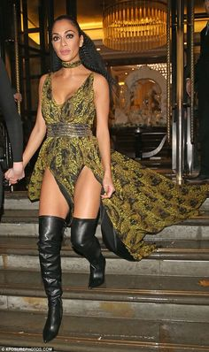 Sizzling: The singer flaunted her ample cleavage as well as her slender limbs thanks to the quirky frock's two thigh-high splits