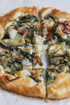 Spinach Mushroom and Artichoke Galette. So delicious and easy to make! Impress your family and friends with this savory tart. It's a perfect recipe for Easter Brunch! I can't believe Easter is about a week and a half away! In my family, we take two things Vegetable Recipes, Vegetarian Recipes, Cooking Recipes, Healthy Recipes, Vegetarian Tart, Salad Recipes, Snacks Recipes, Veggie Food, Free Recipes