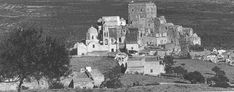 1950s Pyrgos town. a trstegically built city on a pyramid shaped hill overlooking most of Santorini