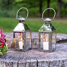 Effortlessly create a mood of romance and light the way for your guests with this versatile lantern. It's chic glass paneling make it the perfect accent piece for both your ceremony and reception. Stainless Lantern With Glass Panels. | eBay!