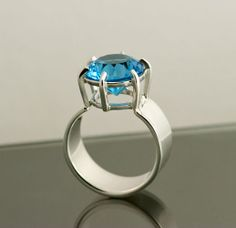 Large Blue Topaz in handmade sterling silver ring www.jenlawlerdesigns.etsy.com