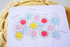 """This multilingual """"Thank You"""" card could work just as well for Mom's Day. Collect a bright-colored print from each family member to make a field of smiley flowers. Get the tutorial at Ishtar Olivera » - GoodHousekeeping.com"""