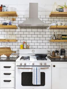 """Open shelving forced some hard decisions for the McCullocks. """"We got rid of our least favorite dishware,"""" Josh says. """"If we've got to look at it, we want to make it nice."""""""