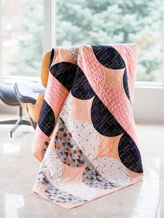 This is the sweetest pink quilt you've ever seen. Try your hand at sewing curved seams and using freezer paper as a quilt template to make two half-spheres.