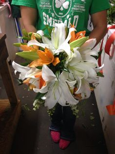 White oriental Lillie's with orange Asiatic lily in a bouquet holder Lily Bouquet Wedding, Lily Wedding, Bouquet Holder, Asiatic Lilies, Types Of Plants, Oriental, Table Decorations, Bridal, Orange