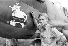 """Crete. c. May 1944. Informal portrait of 425749 Flying Officer (FO) I. G. S. Purssey of Brisbane, Qld, a member of No. 450 Squadron RAAF beside a Curtiss P40 Kittyhawk aircraft with the nose art reading """"Go it Gertie""""."""