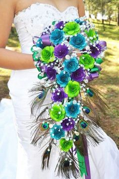 Silk flowers - lime green and aqua blue to go along with Peacock feathers.......what a vibrant bouquet!