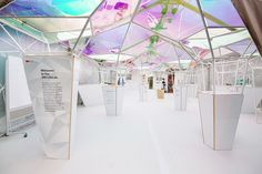 3M's 'lifelab' pavilion at SXSW 2015. The pavilion not only showcases 3M's line of products, but is created almost entirely out of them. The space has a fluid design with structural elements that act as ceiling, spatial partition, and display area simultaneously. 3M's dichroic film–a thin-filter that creates highly saturated colors from light–turns the interior into a dynamic prism of kaleidoscopic colors. http://www.designboom.com/architecture/3m-lifelab-softlab-sxsw-03-26-2015/