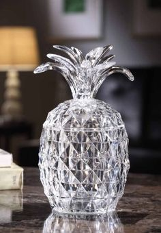 """Lighted Acrylic Pineapple Shaped Home Decor Jar - Symbol of Hospitality by ICY CRAFT CORP. $39.95. On/off switch on base.. Makes the perfect hostess gift.. 9"""" x 4"""".. Built-in illumination and angled cuts cast stunning effects.. Uses 3 AAA batteries, not included.. The pineapple is the very symbol of hospitality, inspired by an 18th-century tradition of serving fresh fruit, a great luxury at the time, to one's guests. Add a welcoming touch to any room with this lovely ..."""