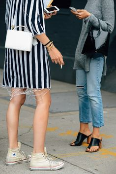 white and black fringe dress with converse, black knit long sleeved sweater worn with ripped denim and black Celine sandals.