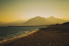 Long white sandy beach at sunset - Orosei