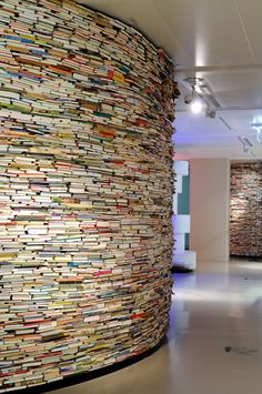 Another innovative way to keep books around~ A wall of books~ this is definitely just a visual experience.  Remove a book, oh my!